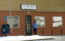 Al Hartmann     The Salt Lake Tribune An Emery resident enters the town's post office, which could close.  Residents who do business and receive medications through the mail would have to drive 15 miles north to Ferron to collect their mail.