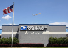 Steve Griffin     The Salt Lake Tribune  Jets fly over the airport U.S. Post Office as they take off from the Salt Lake City International Airport on Tuesday, July 26, 2011. The Post Office is considering closing this office along with 13 other offices in Utah.