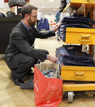 In this Dec. 13, 2011 photo, Brad Cheskes of Chicago, shops at the Macy's on State Street store in Chicago. Many retailers are reporting solid sales gains for December, capping a decent holiday season. (AP Photo/Charles Rex Arbogast)