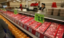 Steve Griffin  |  The Salt Lake Tribune Avolfo Hernandez, a butcher at the new Rancho Markets store, weighs some meat for a customer on Thursday.