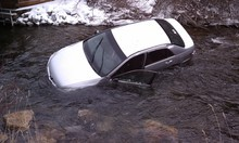 Courtesy KUTV Three children were pulled from submerged car in the Logan River on Saturday. The segment of U.S. 89 is the scene of numerous accidents.