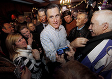 Republican presidential candidate, former Massachusetts Gov. Mitt Romney makes his way through a crowd during a campaign stop at Old Salt Restaurant in Hampton, N.H., Saturday, Dec. 31, 2011. (AP Photo/Winslow Townson)