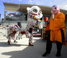 Rick Egan   |  Tribune file photo Performers show the traditional Lion Dance at the ground breaking ceremony for the Chinese Heritage Gate in July 2011.