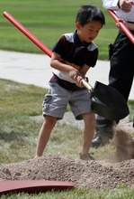 Rick Egan   |  Tribune file photo Dillon Fang, 5, and his brother, Logan Fang, 7, of Bountiful, turn over a shovel of dirt at the groundbreaking ceremony for the Chinese Heritage Gate at the Utah Cultural Celebration Center in West Valley City on  July 26, 2011. The Chinese Heritage Gate commemorates the local Chinese community and the connection between West Valley City and Nantou, Taiwan.