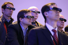 Attendees watch a 3-D HDTV presentation by Panasonic at last year's Consumer Electronics Show, in Las Vegas. The International Consumer Electronics Show is getting a track record as the launch pad for products that fall flat. The annual conclave kicks off Tuesday. (AP Photo/Julie Jacobson, File)