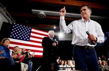 Republican presidential candidate, former Massachusetts Gov. Mitt Romney, campaigns with Sen. John McCain, R-Ariz., at the Boys and Girls Club in Salem, N.H., Thursday, Jan. 5, 2012. (AP Photo/Charles Dharapak)