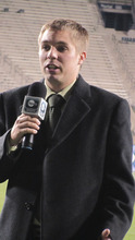 Robbie Bullough working the sidelines of a football game for BYUtv. Courtesy photo