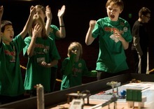 Kim Raff I The Salt Lake Tribune Droidzilla, a team based out of the Boys & Girls Club of South Valley, celebrates a score during a Utah FIRST LEGO League competition at Murray High School on Saturday.