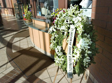 Paul Fraughton | The Salt Lake Tribune. A memorial wreath along with other flower arrangements  in the lobby of the Ogden City Police headquarters.  Friday, January 6, 2012