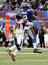Atlanta Falcons defensive back Chris Owens (21) breaks up a pass intended for New York Giants wide receiver Mario Manningham (82) during the first half of an NFL wild card playoff football game Sunday, Jan. 8, 2012, in East Rutherford, N.J. (AP Photo/Bill Kostroun)