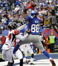 New York Giants wide receiver Hakeem Nicks (88) pulls down a four yard touchdown pass against Atlanta Falcons cornerback Dominique Franks (24) during the first half of an NFL wild card playoff football game Sunday, Jan. 8, 2012, in East Rutherford, N.J. (AP Photo/Bill Kostroun)