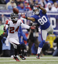 New York Giants wide receiver Victor Cruz can reach a pass against Atlanta Falcons cornerback Dominique Franks (24) during the second half of an NFL wild card playoff football game Sunday, Jan. 8, 2012, in East Rutherford, N.J. (AP Photo/Matt Slocum)