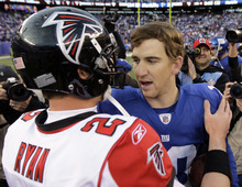 New York Giants quarterback Eli Manning, right, is congratulated by Atlanta Falcons quarterback Matt Ryan following their NFL wild card playoff football game Sunday, Jan. 8, 2012, in East Rutherford, N.J. The Giants defeated the Falcons 24-2. (AP Photo/Julio Cortez)