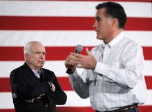Sen. John McCain, R-Ariz. listens at left as Republican presidential candidate former Massachusetts Gov. Mitt Romney speaks at a Boys and Girls Club, Thursday, Jan. 5, 2012, in Salem, N.H. (AP Photo/Matt Rourke)