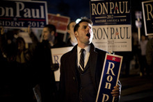 Supporters of Republican presidential candidate, Rep. Ron Paul, shout support outside the Republican presidential debate site on Saturday, Jan. 7, 2012 in Manchester, N.H.  (AP Photo/Evan Vucci)