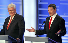 Elise Amendola  |  The Associated Press Former House Speaker Newt Gingrich, left, listens to Texas Gov. Rick Perry answer a question during a Republican presidential candidate debate at Saint Anselm College in Manchester, N.H., Saturday.