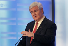 Elise Amendola  |  The Associated Press Former House Speaker Newt Gingrich answers a question during a Republican presidential candidate debate at Saint Anselm College in Manchester, N.H., Saturday.