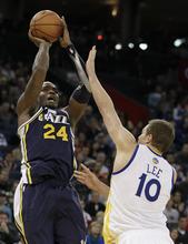 Utah Jazz's Paul Millsap (24) shoots over Golden State Warriors' David Lee (10) during the second half of an NBA basketball game Saturday, Jan. 7, 2012, in Oakland, Calif. (AP Photo/Ben Margot)