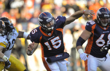 Denver Broncos quarterback Tim Tebow (15) throws in the first quarter of an NFL wild card playoff football game against the Pittsburgh Steelers, Sunday, Jan. 8, 2012, in Denver.  (AP Photo/Jack Dempsey)