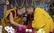 Tibetan spiritual leader the Dalai Lama greets Tibetan Buddhism's third most important leader Ugyen Thinley Dorje, the 17th Karmapa, before a Kalachakra initiation session, in Bodh Gaya, Bihar, India, Monday, Jan. 9, 2012. Bodh Gaya  is believed to be the place where Buddha attained enlightenment.(AP Photo/Altaf Qadri)