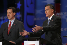 Former Massachusetts Gov. Mitt Romney, right, answers a question and former Pennsylvania Sen. Rick Santorum listens during a Republican presidential candidate debate at the Capitol Center for the Arts in Concord, N.H., Sunday, Jan. 8, 2012. (AP Photo/Charles Krupa)