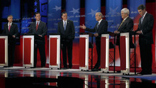 Rep. Ron Paul, R-Texas, center right, answers a question as former Utah Gov. Jon Huntsman, former Pennsylvania Sen. Rick Santorum, former Massachusetts Gov. Mitt Romney, former House Speaker Newt Gingrich and Texas Gov. Rick Perry (L-R) during a Republican presidential candidate debate at the Capitol Center for the Arts in Concord, N.H., Sunday, Jan. 8, 2012. (AP Photo/Charles Krupa)