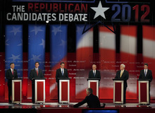 Former Utah Gov. Jon Huntsman, former Pennsylvania Sen. Rick Santorum, former Massachusetts Gov. Mitt Romney, Rep. Ron Paul, R-Texas,, former House Speaker Newt Gingrich and Texas Gov. Rick Perry (L-R) listen to a question from NBC Meet the Press moderator David Gregory during a Republican presidential candidate debate at the Capitol Center for the Arts in Concord, N.H., Sunday, Jan. 8, 2012. (AP Photo/Charles Krupa)