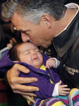 Republican presidential candidate, former Utah Gov. Jon Huntsman kisses eight-week-old Grace Lesperance while campaigning at Mary's Bakery and Cafe in Henniker, N.H. Monday, Jan. 9, 2012. (AP Photo/Elise Amendola)