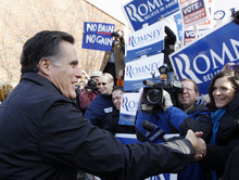 Republican presidential candidate, former Massachusetts Gov. Mitt Romney, campaigns on primary election day outside of a polling station at Webster School in Manchester, N.H., Tuesday, Jan. 10, 2012. (AP Photo/Charles Dharapak)