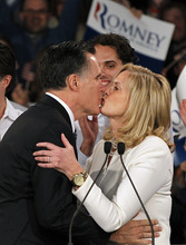Former Massachusetts Gov. Mitt Romney kisses his wife Ann as he arrives at the Romney for President New Hampshire primary night victory party at Southern New Hampshire University in Manchester, N.H., Tuesday, Jan. 10, 2012. (AP Photo/Elise Amendola)