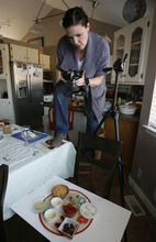 Francisco Kjolseth  |  The Salt Lake Tribune Allison Czarnecki, a mommy blogger from Spanish Fork, takes advantage of window light to document a new vegan recipe in her kitchen for the family dinner on Monday, Jan. 9, 2012. Czarnecki, who started her blog petitelefant.com in 2007, has a following of about half a million a month. A recent study shows that stay-at-home moms who blog are much happier due to an increased social network that keeps them connected.