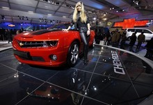 A model poses in a Chevrolet Camaro at the Auto Expo in New Delhi, India, Tuesday, Jan. 10, 2012. The annual week-long automobile event ends Wednesday. (AP Photo/Mustafa Quraishi)