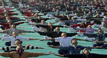 Indian schoolchildren perform yoga during a rehearsal for the inaugural ceremony of the International Kite Festival in Ahmadabad, India, Tuesday, Jan. 10, 2011. One Hundred and twenty kite flyers from India and abroad are expected to participate in the five-day long festival, which begins Tuesday. (AP Photo/Ajit Solanki)