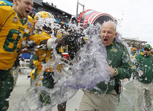North Dakota State head coach Craig Bohl is doused with water in the final seconds of their 17-6 win over North Dakota State in the FCS championship NCAA college football game against  Sam Houston Saturday, Jan. 7, 2012, in Frisco, Texas. (AP Photo/LM Otero)