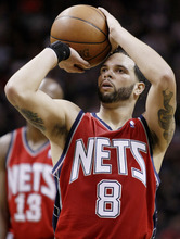 New Jersey Nets' Deron Williams shoots a free throw during the second half of an NBA basketball game against the San Antonio Spurs, Friday, Feb. 25, 2011, in San Antonio. San Antonio won 106-96. (AP Photo/Darren Abate)