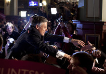 Republican presidential candidate, former Utah Gov. Jon Huntsman shakes hands after speaking at an primary election night rally Tuesday, Jan. 10, 2012, in Manchester, N.H.  (AP Photo/Evan Vucci)