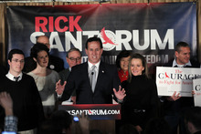 Republican presidential candidate former Pennsylvania Sen. Rick Santorum, accompanied by his wife Karen, center right, son Daniel, left, and daughter, Elizabeth, second left, speaks during a primary night rally, Tuesday, Jan. 10, 2012, in Manchester, N.H. (AP Photo/Matt Rourke)