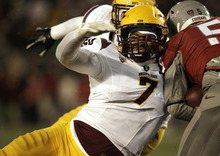 Arizona State linebacker Vontaze Burfict (7) tackles Washington State running back Rickey Galvin (5) during the first half of an NCAA college football game, Saturday, Nov. 12, 2011, in Pullman, Wash. (AP Photo/Dean Hare)