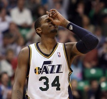 Steve Griffin  |  The Salt Lake Tribune  Utah's C.J. Miles holds his hand to his face after nailing a late three pointer during second half action in the Jazz Cleveland game at EnergySolutions Arena in Salt Lake City, Utah  Tuesday, January 10, 2012.