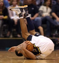 Steve Griffin  |  The Salt Lake Tribune  Utah's Devin Harris rolls onto his back after striping the ball from Cleveland's Kyrie Irving during second half action in the Jazz Cleveland game at EnergySolutions Arena in Salt Lake City, Utah  Tuesday, January 10, 2012. Harris was called for a foul on the play.