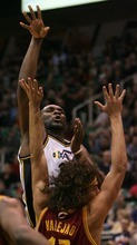 Steve Griffin  |  The Salt Lake Tribune  Utah's Al Jefferson shoots over Cleveland's Anderson Varejao during second half action in the Jazz Cleveland game at EnergySolutions Arena in Salt Lake City, Utah  Tuesday, January 10, 2012.