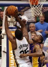 Steve Griffin  |  The Salt Lake Tribune  Andrew Bynum, of the Lakers, blocks Al Jefferson's last second shot during second half action of the Jazz versus Lakers game at EnergySlutions Arena in Salt Lake City, Utah  Wednesday, January 11, 2012.