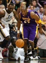 Steve Griffin  |  The Salt Lake Tribune  Kobe Bryant, of the Lakers, scoops up the ball and heads up court during second half action of the Jazz versus Lakers game at EnergySlutions Arena in Salt Lake City, Utah  Wednesday, January 11, 2012.