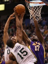 Steve Griffin  |  The Salt Lake Tribune  Utah's Enes Kanter and Derrick Favors battle Andrew Bynum, of the Lakers, during first half action of the Jazz versus Lakers game at EnergySlutions Arena in Salt Lake City, Utah  Wednesday, January 11, 2012.