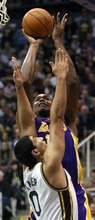 Steve Griffin  |  The Salt Lake Tribune  Utah's Enes Kanter defends the shot of Andrew Bynum, of the Lakers, during first half action of the Jazz versus Lakers game at EnergySlutions Arena in Salt Lake City, Utah  Wednesday, January 11, 2012.