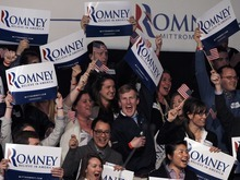 Supporters at the  for Romney for President New Hampshire primary night rally at Southern New Hampshire University in Manchester, N.H., Tuesday, Jan. 10, 2012 cheer as it is announced that the election has been called for former Massachusetts Gov. Mitt Romney. (AP Photo/Elise Amendola)