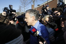 Republican presidential candidate, former Utah Gov. Jon Huntsman, makes it pass a crush of reporters as he campaigns on primary election day outside of a polling station at Webster School in Manchester, N.H., Tuesday, Jan. 10, 2012. (AP Photo/Charles Dharapak)