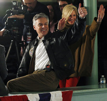 Republican presidential candidate, former Utah Gov. Jon Huntsman and his wife Mary Kaye turns and gestures to the crowd after doing a television interview prior to a campaign rally in Exeter, N.H., Monday, Jan. 9, 2012. (AP Photo/Elise Amendola)