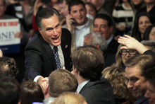 Former Massachusetts Gov. Mitt Romney greets supporters at the Romney for President New Hampshire primary night victory party  at Southern New Hampshire University in Manchester, N.H., Tuesday, Jan. 10, 2012. (AP Photo/Elise Amendola)