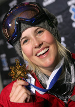 In this Jan. 23, 2009 file photo, Sarah Burke, of Canada, holds her gold metal after winning the Women's Superpipe event at Winter X Games 13 at Buttermilk Ski Area, near Aspen, Colo. Burke remains in a coma, a day after she was airlifted from the mountains of Utah to a Salt Lake City hospital with serious injuries after a training accident in the superpipe. (AP Photo/Nathan Bilow, File)